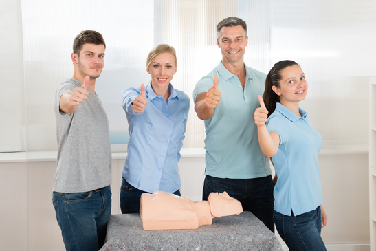 People With Thumbs Up Sign While Learning Resuscitation